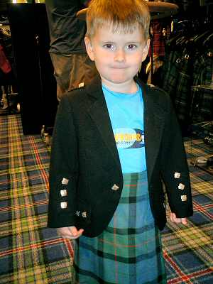 Alex getting fitted for a kilt