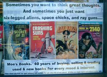 Photo of Moe's books shop window:  'Sometimes you want to think great thoughts.  And sometimes you just want six-legged aliens, space chicks, and ray guns....'
